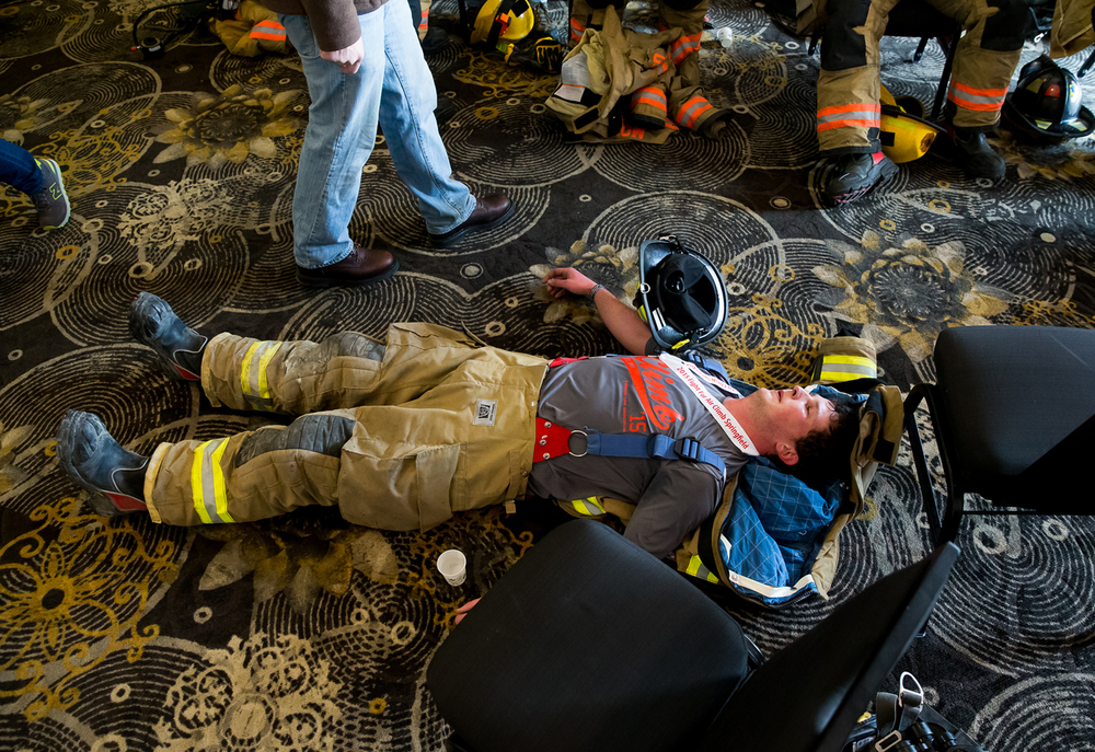 Carlinville firefighter Blake Hyman catches his breath after climbing 32 flights of stairs during the American Lung Association in Illinois' 2015 Fight for Air Climb at the Hilton, Sunday, Feb. 8, 2015, in Springfield, Ill. Justin L. Fowler/The State Journal-Register