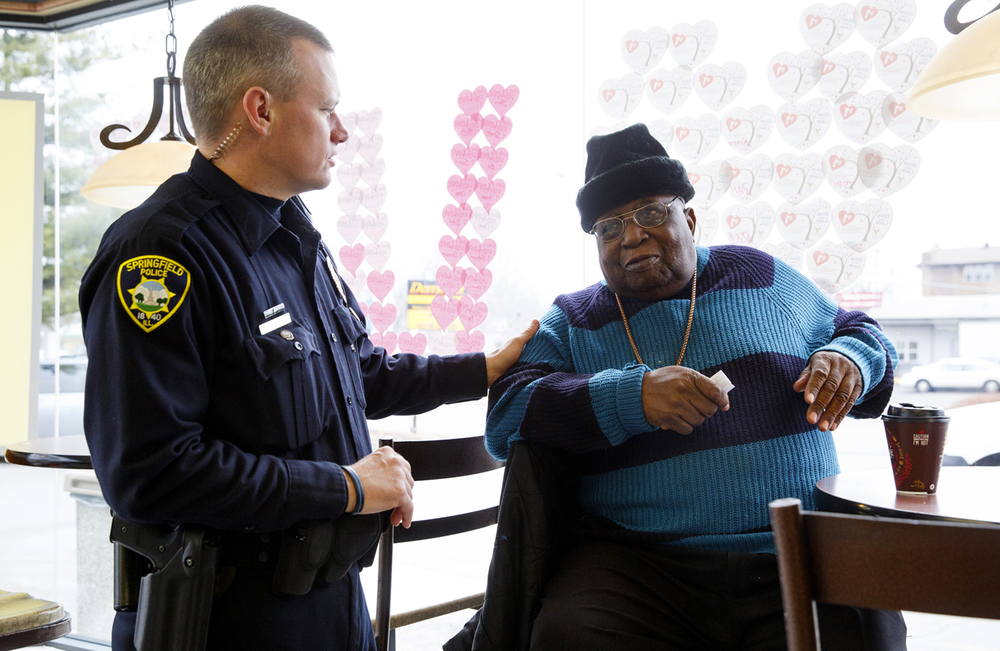 Springfield Police Officer Bryan Henson talks with William Logan during a Coffee with a Cop event Wednesday, Feb. 11, 2015 at McDonald's on South Grand Avenue East. Rich Saal/The State Journal-Register