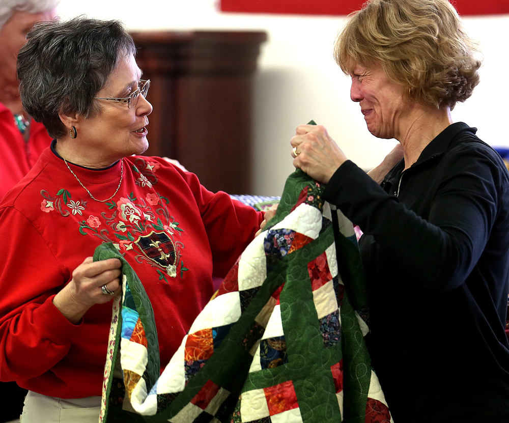 "A tearful Tina Kern at right is presented with a special ""Rosalie's 