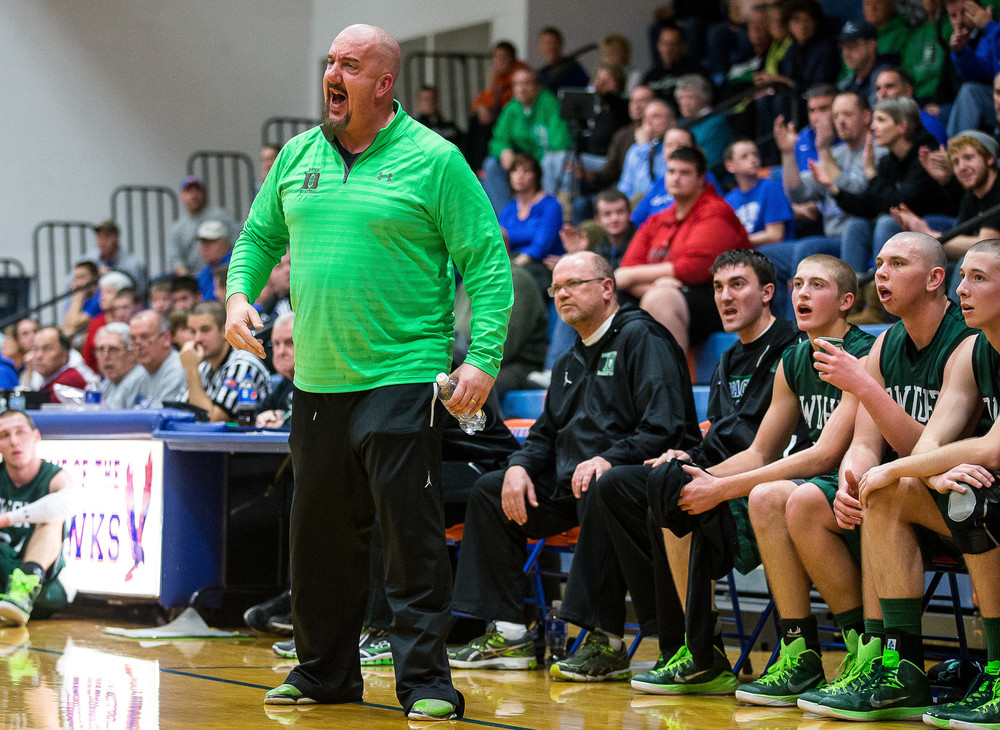 Dwight boys basketball head coach Eric Long calls out instructions to his team as they take on Lutheran in the first half during the Riverton Shootout at the Hawk Center, Saturday, Feb. 14, 2015, in Riverton, Ill. Justin L. Fowler/The State Journal-Register