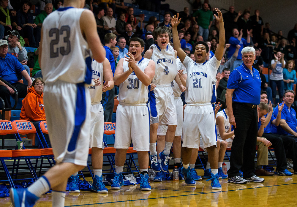Lutheran's Sidney Squires (21) and the bench erupt after the Crusaders force a Dwight turnover late in the second half during the Riverton Shootout at the Hawk Center, Saturday, Feb. 14, 2015, in Riverton, Ill. Justin L. Fowler/The State Journal-Register