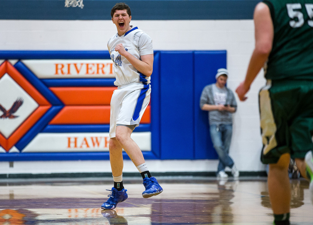 Lutheran's Jacob Pfieffer (24) reacts after scoring a basket in overtime during the Riverton Shootout at the Hawk Center, Saturday, Feb. 14, 2015, in Riverton, Ill. Justin L. Fowler/The State Journal-Register