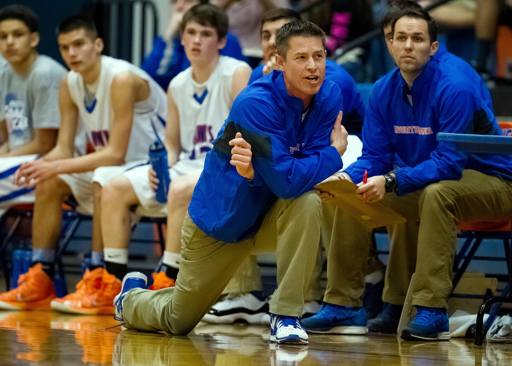Riverton boys basketball head coach Kyle Weber on the sidelines as the Hawks take on Hillsboro in the first half during the Riverton Shootout at the Hawk Center, Saturday, Feb. 14, 2015, in Riverton, Ill. Justin L. Fowler/The State Journal-Register