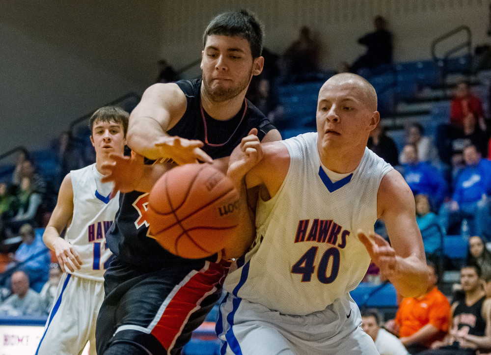 Hillsboro's Dylan Miller (42) and Riverton's Blake Suhling (40) go for a loose ball in the second half during the Riverton Shootout at the Hawk Center, Saturday, Feb. 14, 2015, in Riverton, Ill. Justin L. Fowler/The State Journal-Register