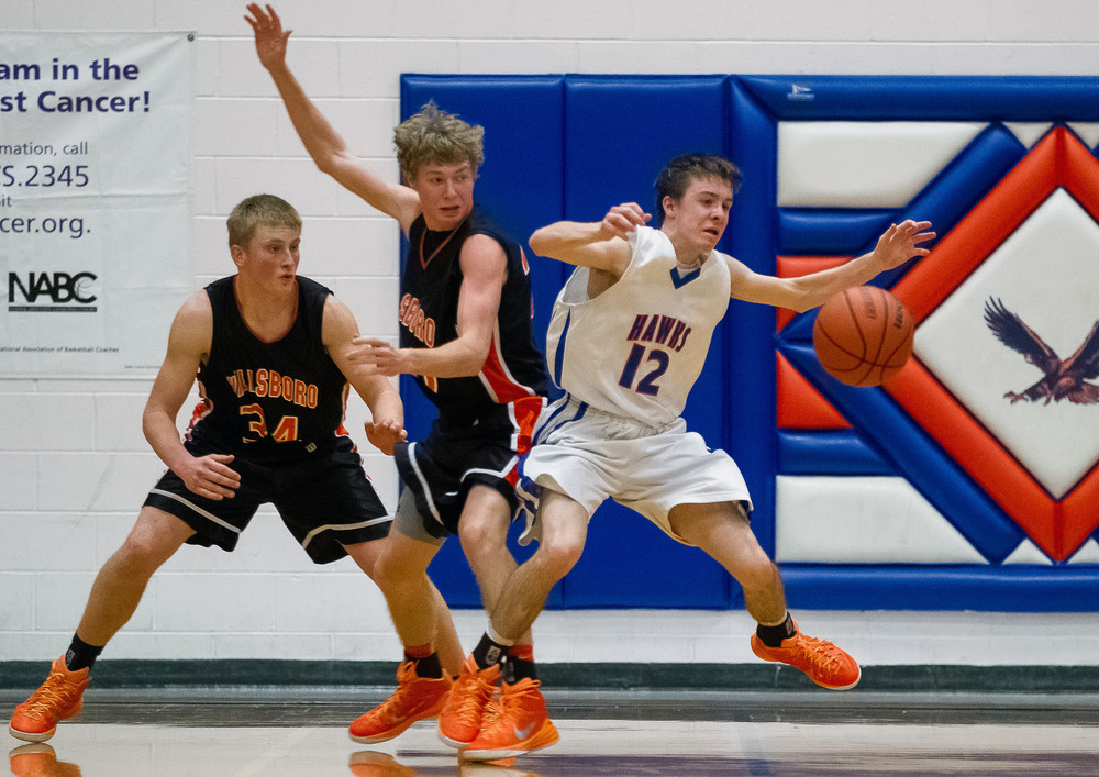 Riverton's Ryan Roscetti (12) turns the ball over as he tries to spin around Hillsboro's Cody Caulk (20) in the second half during the Riverton Shootout at the Hawk Center, Saturday, Feb. 14, 2015, in Riverton, Ill. Justin L. Fowler/The State Journal-Register
