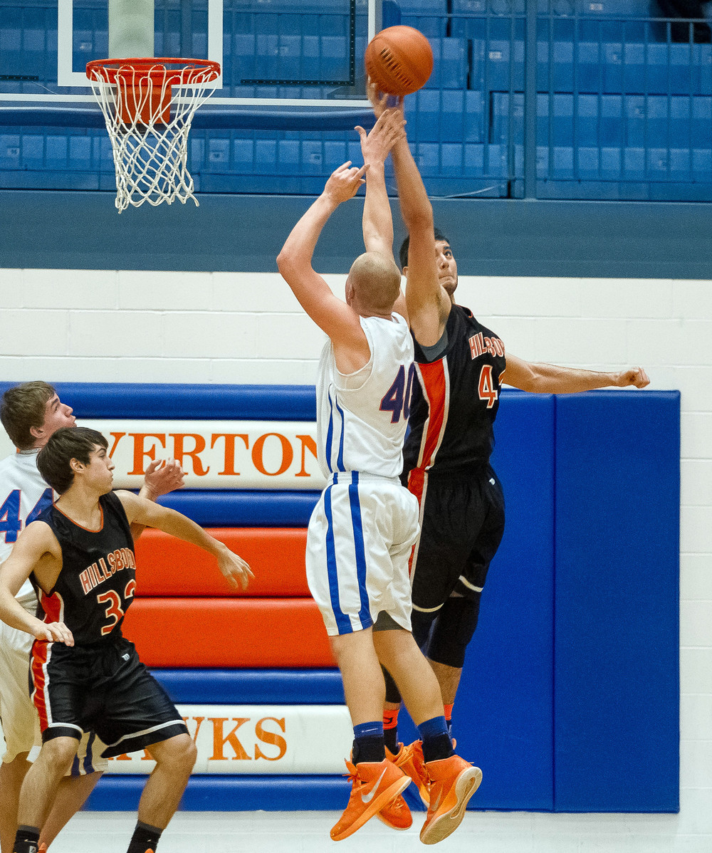 Hillsboro's Dylan Miller (42) blocks a shot from Riverton's Blake Suhling (40) in the second half during the Riverton Shootout at the Hawk Center, Saturday, Feb. 14, 2015, in Riverton, Ill. Justin L. Fowler/The State Journal-Register