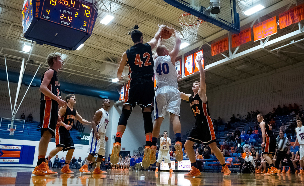 Hillsboro's Dylan Miller (42) blocks a shot from Riverton's Blake Suhling (40) in the first half during the Riverton Shootout at the Hawk Center, Saturday, Feb. 14, 2015, in Riverton, Ill. Justin L. Fowler/The State Journal-Register
