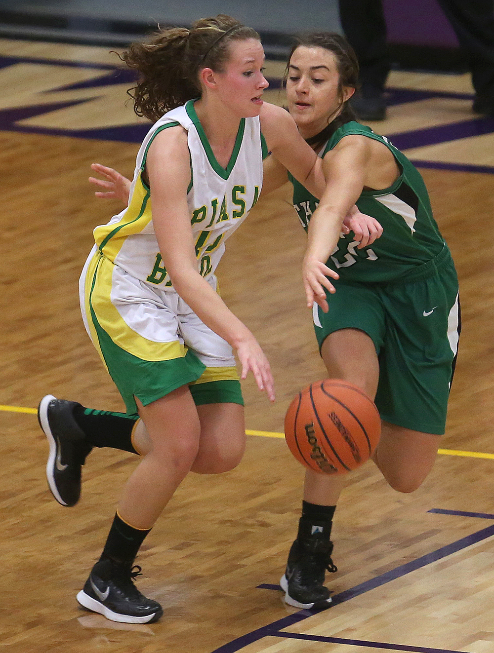Piasa player Payton Heyen tries to get around Athens player JJ Penrod.  Athens High School defeated Piasa Southwestern 44-39 in 2A girls sectional basketball action at Williamsville High School gym on Tuesday evening, Feb. 17, 2015. David Spencer/The State Journal-Register