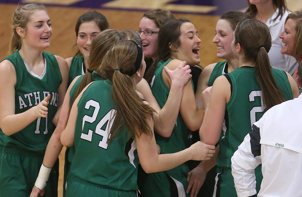 Athens players celebrate their victory, including JJ Penrod at center, at the end of the game Tuesday night. Athens High School defeated Piasa Southwestern 44-39 in 2A girls sectional basketball action at Williamsville High School gym on Tuesday evening, Feb. 17, 2015. David Spencer/The State Journal-Register