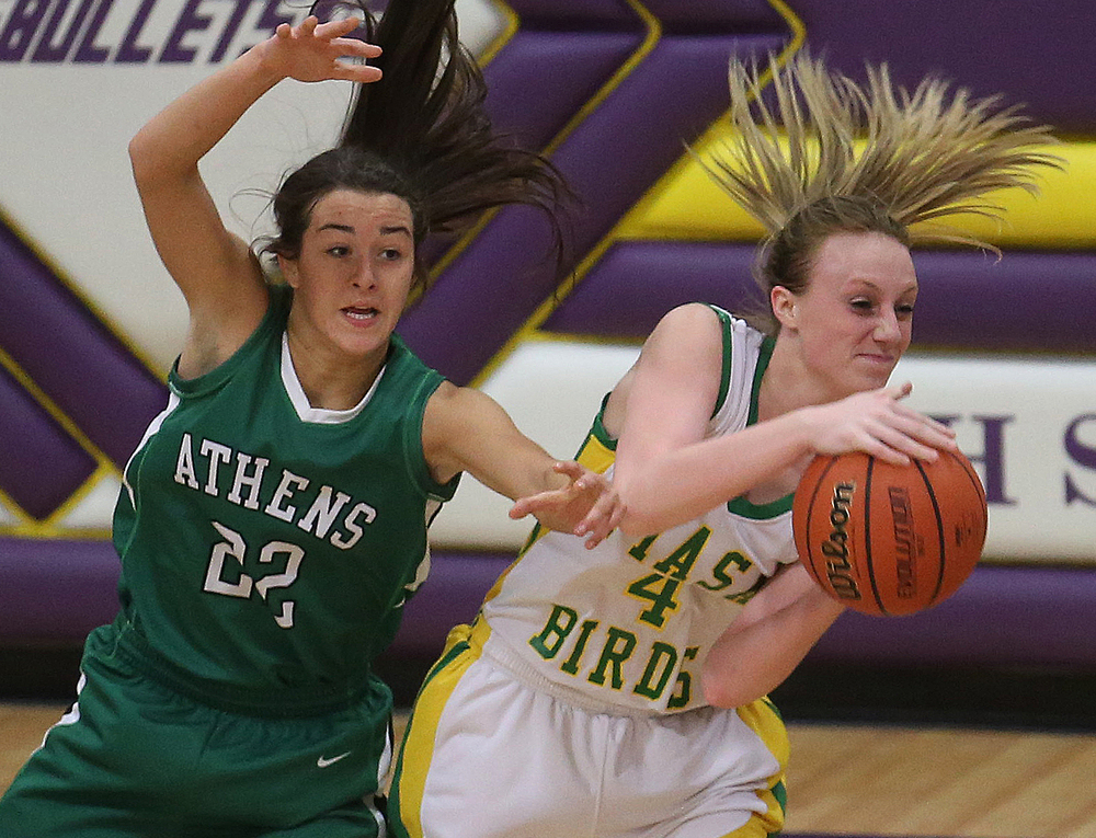 Piasa player Karlie Green looks to pass while Athens player JJ Penrod defends.  Athens High School defeated Piasa Southwestern 44-39 in 2A girls sectional basketball action at Williamsville High School gym on Tuesday evening, Feb. 17, 2015. David Spencer/The State Journal-Register