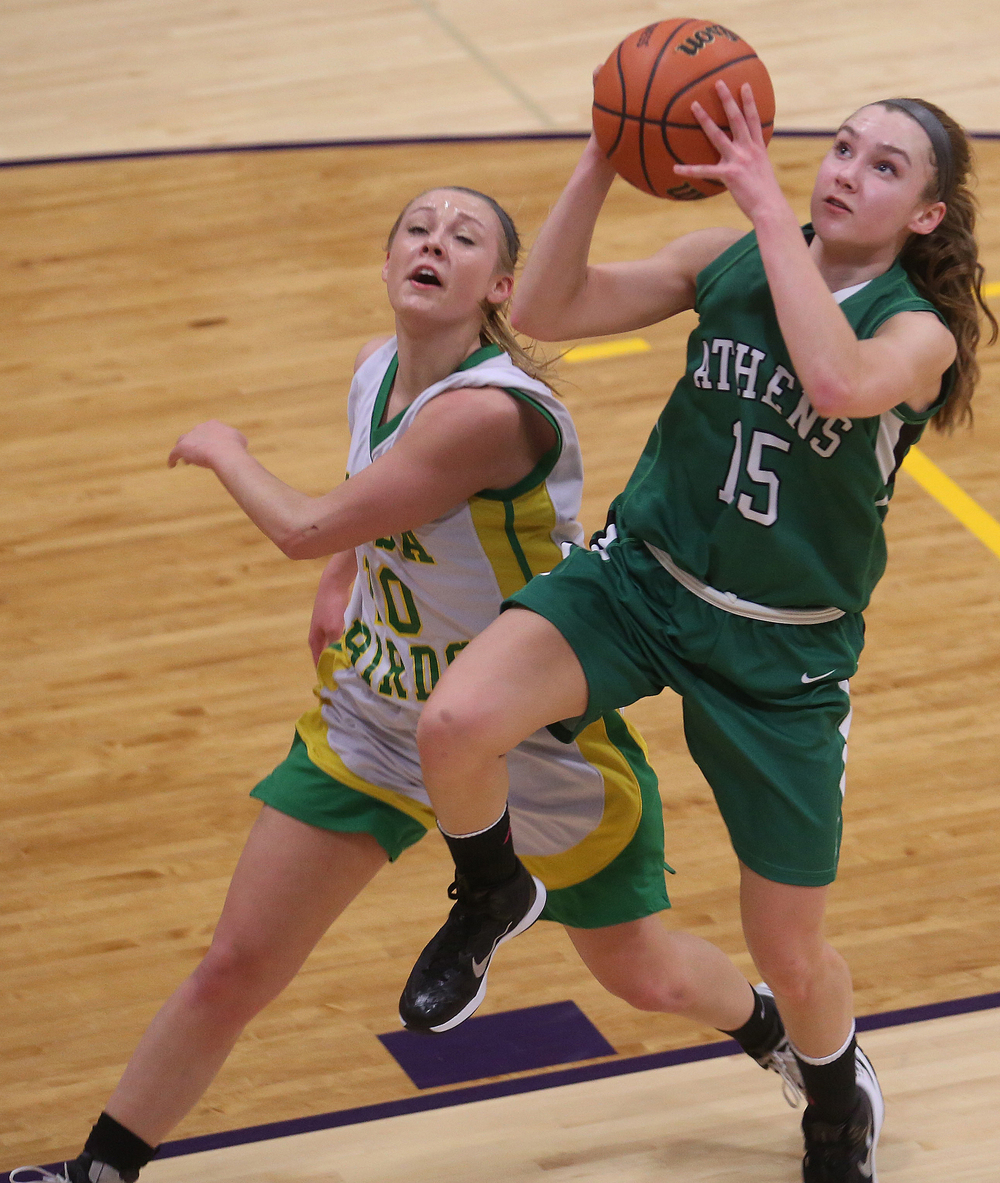 Athens player Emily Nordsiek  puts up two points. Athens High School defeated Piasa Southwestern 44-39 in 2A girls sectional basketball action at Williamsville High School gym on Tuesday evening, Feb. 17, 2015. David Spencer/The State Journal-Register