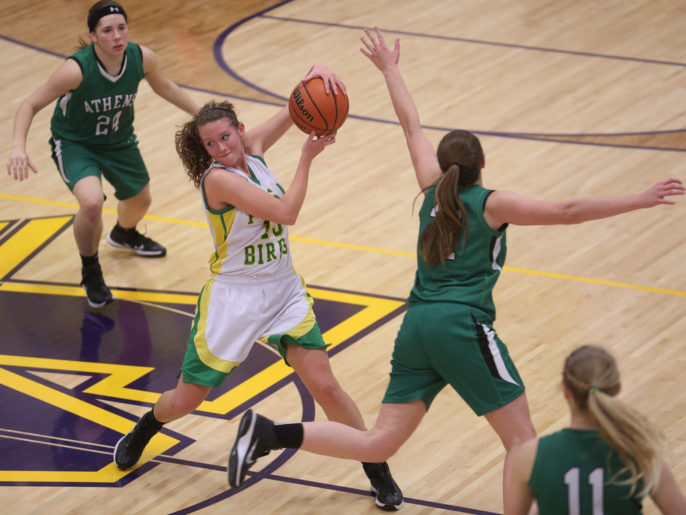 Piasa player Payton Heyen does a dance while grabbing a rebound. Athens High School defeated Piasa Southwestern 44-39 in 2A girls sectional basketball action at Williamsville High School gym on Tuesday evening, Feb. 17, 2015. David Spencer/The State Journal-Register