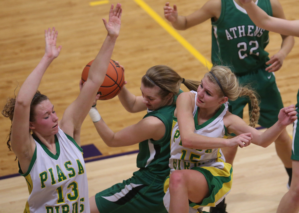 Athens player Lauren Ogden is squeezed by Piasa players Payton Heyen at left and Erin Laubscher. Athens High School defeated Piasa Southwestern 44-39 in 2A girls sectional basketball action at Williamsville High School gym on Tuesday evening, Feb. 17, 2015. David Spencer/The State Journal-Register