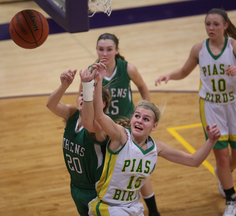 Athens player Lauren Ogden at left and Piasa player Erin Laubscher fight for the ball. Athens High School defeated Piasa Southwestern 44-39 in 2A girls sectional basketball action at Williamsville High School gym on Tuesday evening, Feb. 17, 2015. David Spencer/The State Journal-Register