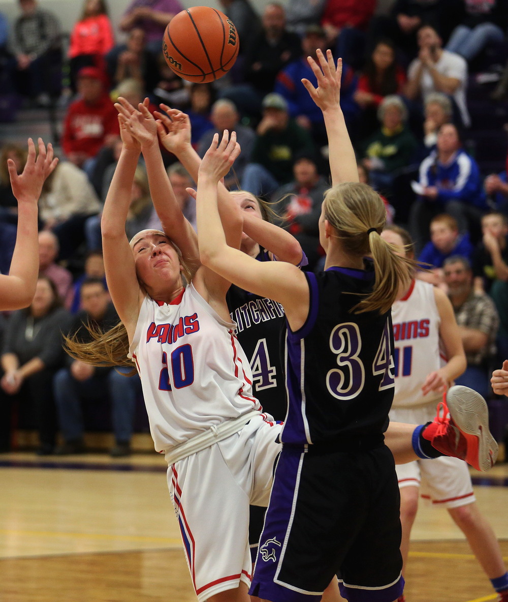 Pleasant Plains player Emily Yakel tries to grab a rebound under heavy pressure from Litchfield Tuesday night. Litchfield defeated Pleasant Plains 22-21 in 2A girls sectional basketball action at Williamsville High School gym on Tuesday evening, Feb. 17, 2015. David Spencer/The State Journal-Register