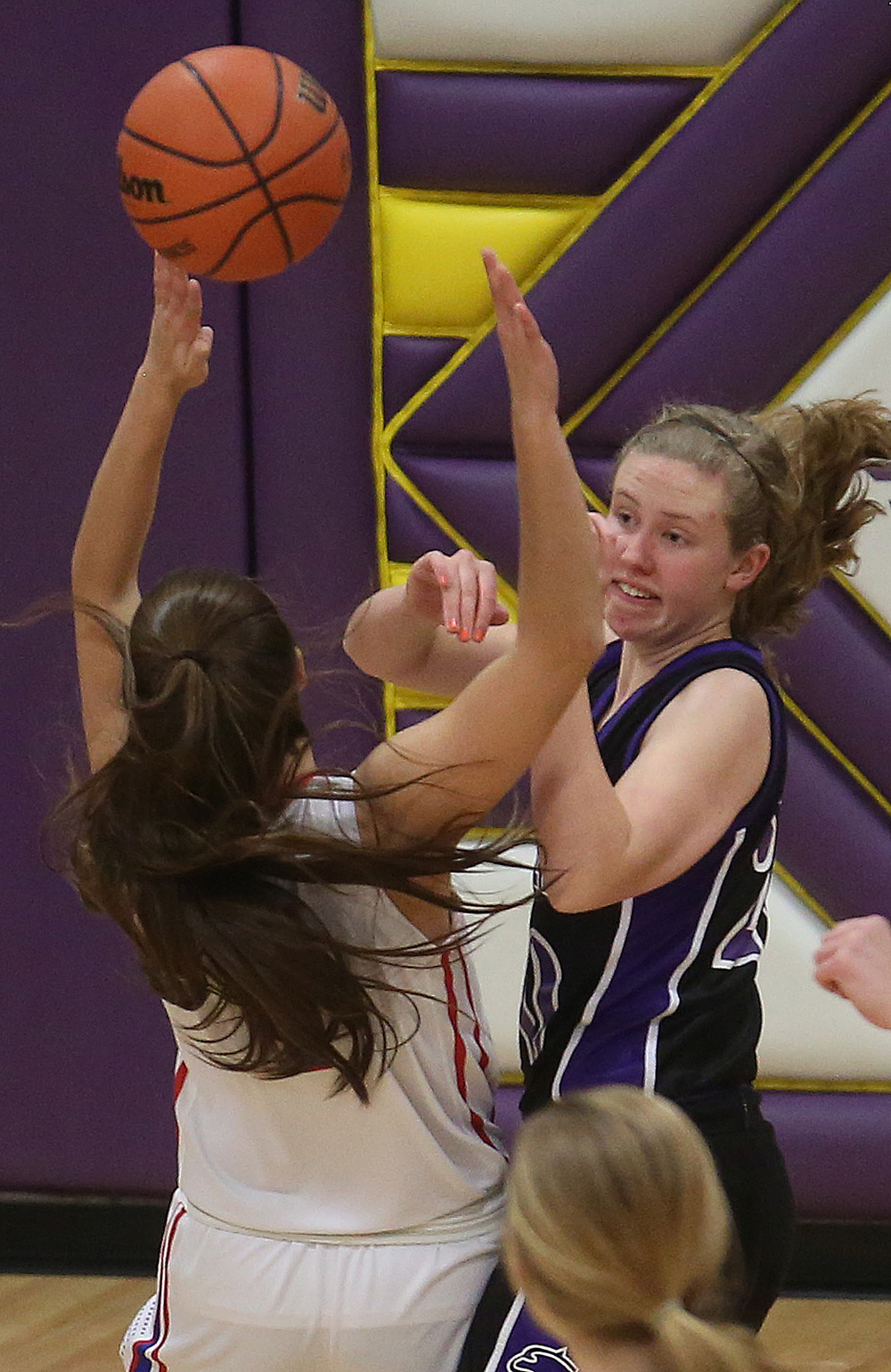 Litchfield's Anna Thomack passes the ball past Plains player Amber Clouser. Litchfield defeated Pleasant Plains 22-21 in 2A girls sectional basketball action at Williamsville High School gym on Tuesday evening, Feb. 17, 2015. David Spencer/The State Journal-Register