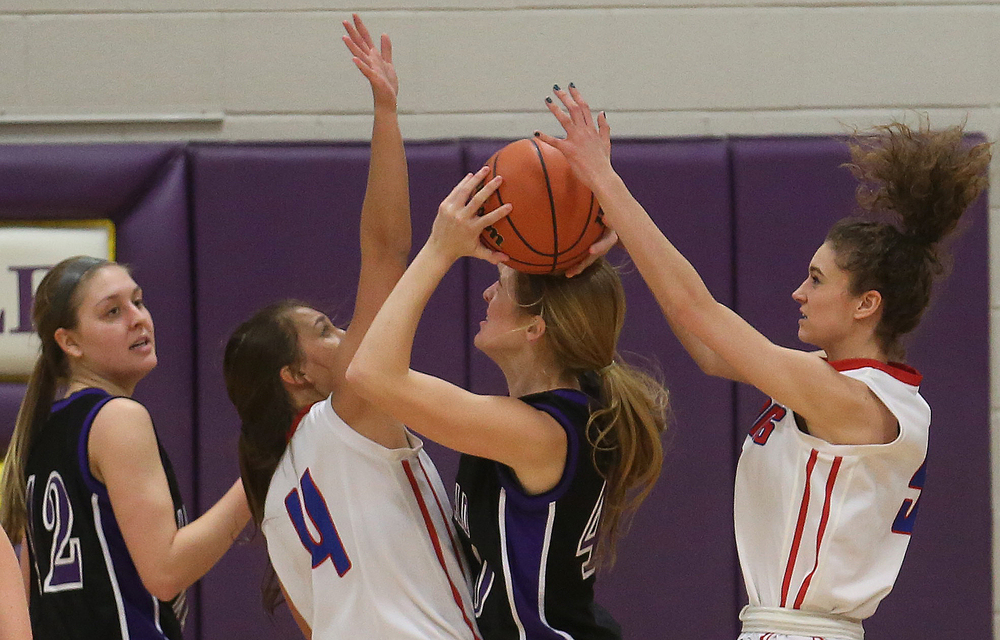Litchfield's Riley Scharf comes under heavy pressure while trying to score including from Plains player Ali Pankey at right and Amber Clouser. Litchfield defeated Pleasant Plains 22-21 in 2A girls sectional basketball action at Williamsville High School gym on Tuesday evening, Feb. 17, 2015. David Spencer/The State Journal-Register