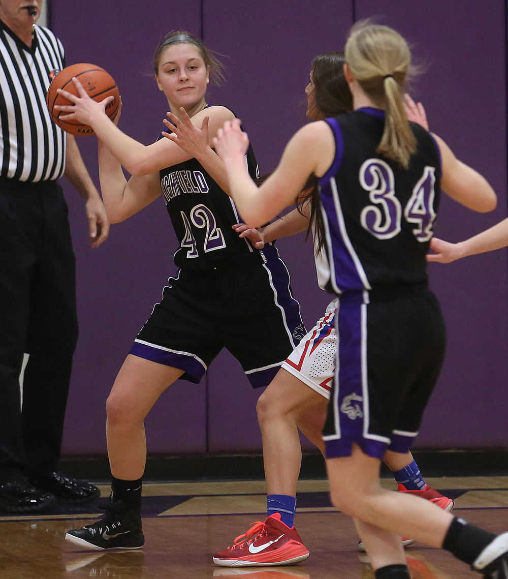 Litchfield's Ally Smith looks to pass to teammate Tessa Steffens.  Litchfield defeated Pleasant Plains 22-21 in 2A girls sectional basketball action at Williamsville High School gym on Tuesday evening, Feb. 17, 2015. David Spencer/The State Journal-Register