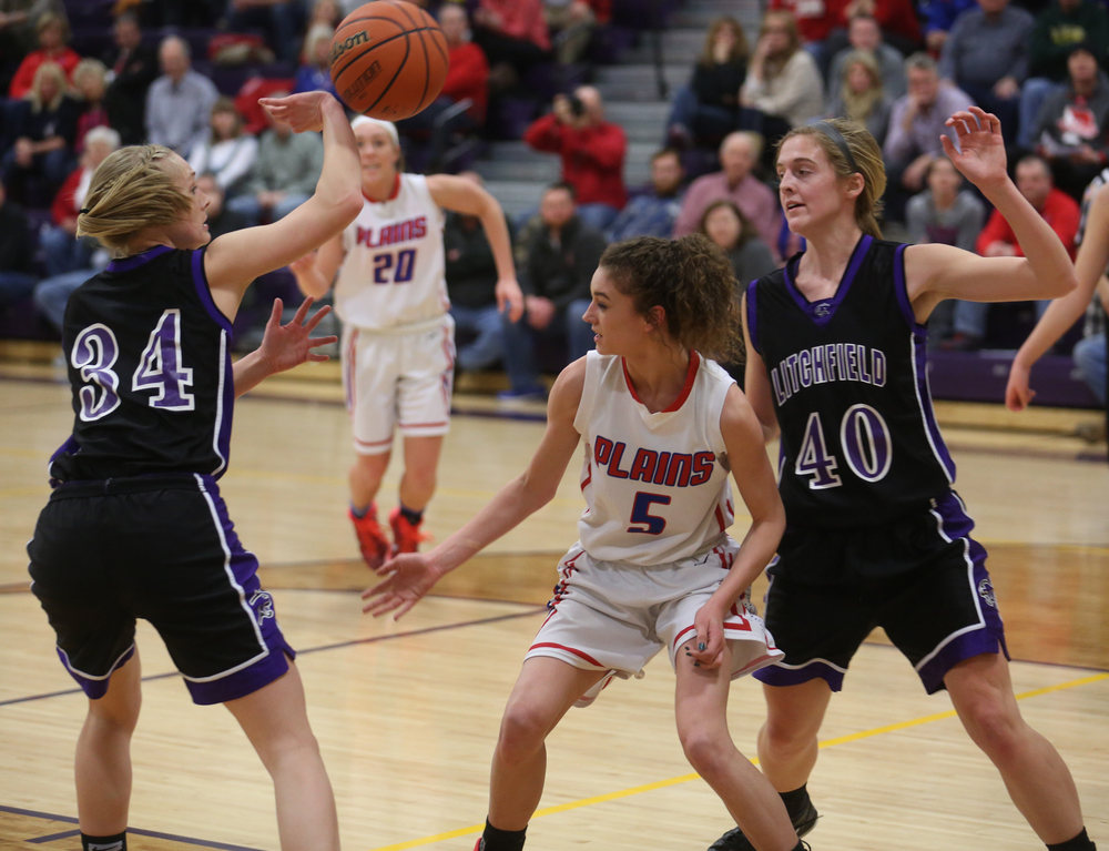 Litchfield's Tessa Steffens at left deflects a loose ball. Litchfield defeated Pleasant Plains 22-21 in 2A girls sectional basketball action at Williamsville High School gym on Tuesday evening, Feb. 17, 2015. David Spencer/The State Journal-Register