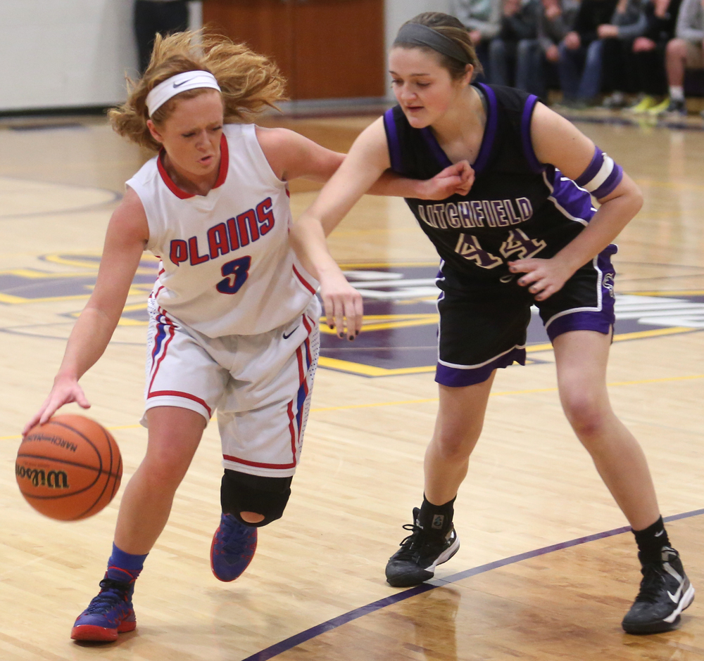 Plains player Rachel Smith drives around Litchfield player Abby Frerichs. Litchfield defeated Pleasant Plains 22-21 in 2A girls sectional basketball action at Williamsville High School gym on Tuesday evening, Feb. 17, 2015. David Spencer/The State Journal-Register