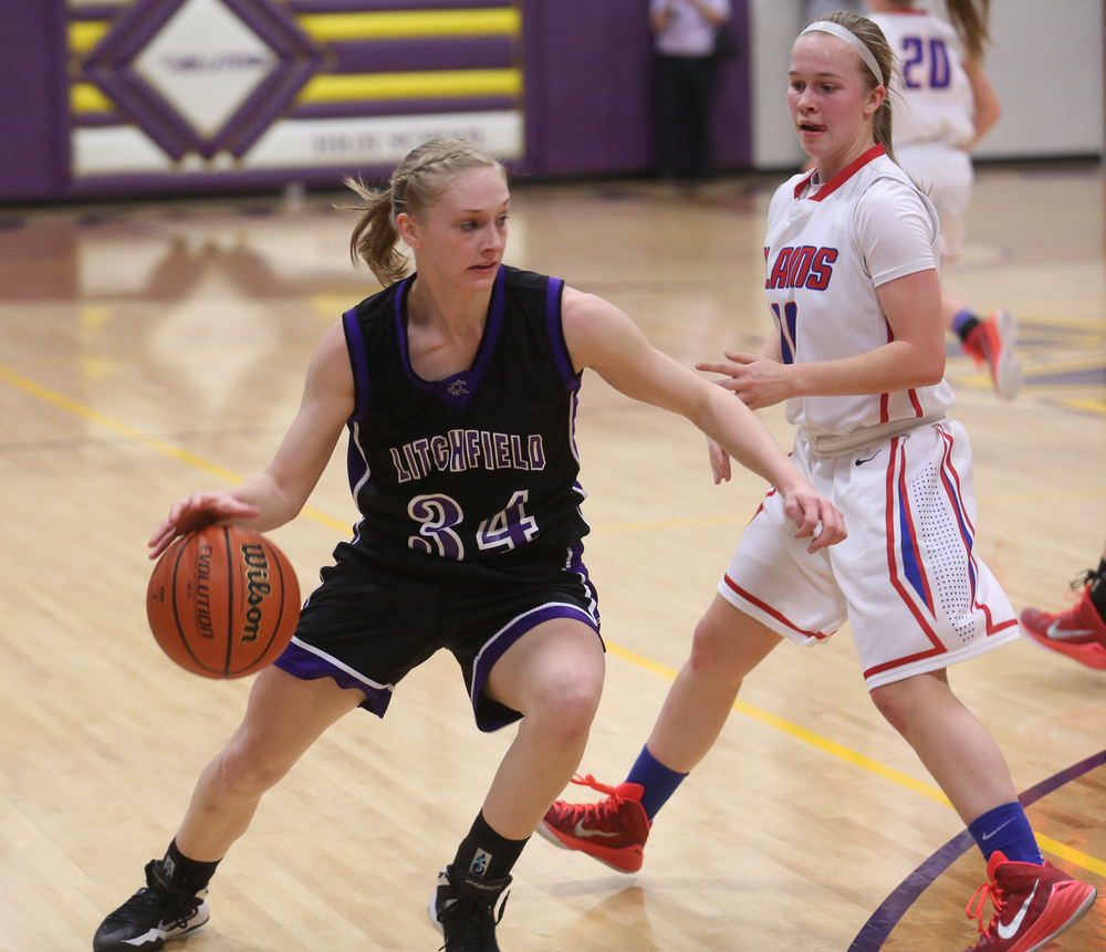 Litchfield player Tessa Steffans gets around Plains player Emily Yakel. Litchfield defeated Pleasant Plains 22-21 in 2A girls sectional basketball action at Williamsville High School gym on Tuesday evening, Feb. 17, 2015. David Spencer/The State Journal-Register