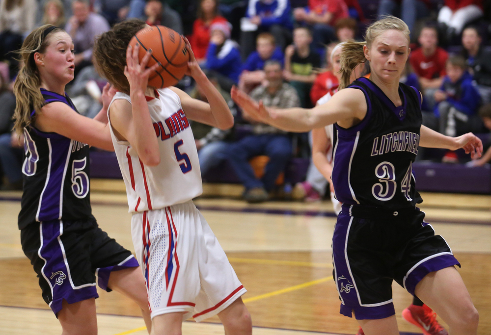 Plains player Ali Pankey is defended by Litchfield players Helen Vargo at left and Tessa Steffens. Litchfield defeated Pleasant Plains 22-21 in 2A girls sectional basketball action at Williamsville High School gym on Tuesday evening, Feb. 17, 2015. David Spencer/The State Journal-Register