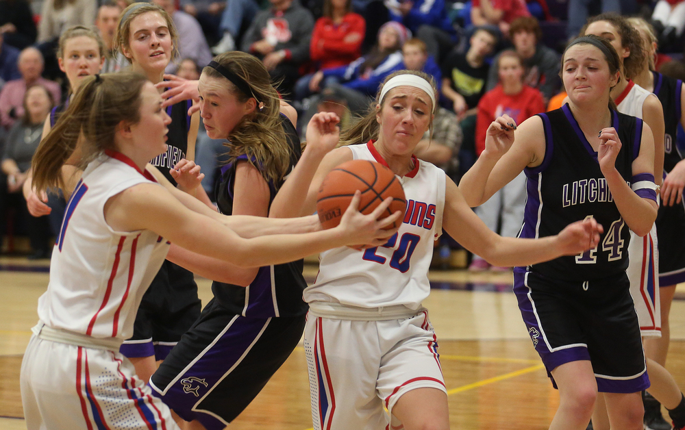 Plains player Lauren Feagans grabs a rebound at left while teammate Emily Yakel looks on at middle. Litchfield defeated Pleasant Plains 22-21 in 2A girls sectional basketball action at Williamsville High School gym on Tuesday evening, Feb. 17, 2015. David Spencer/The State Journal-Register