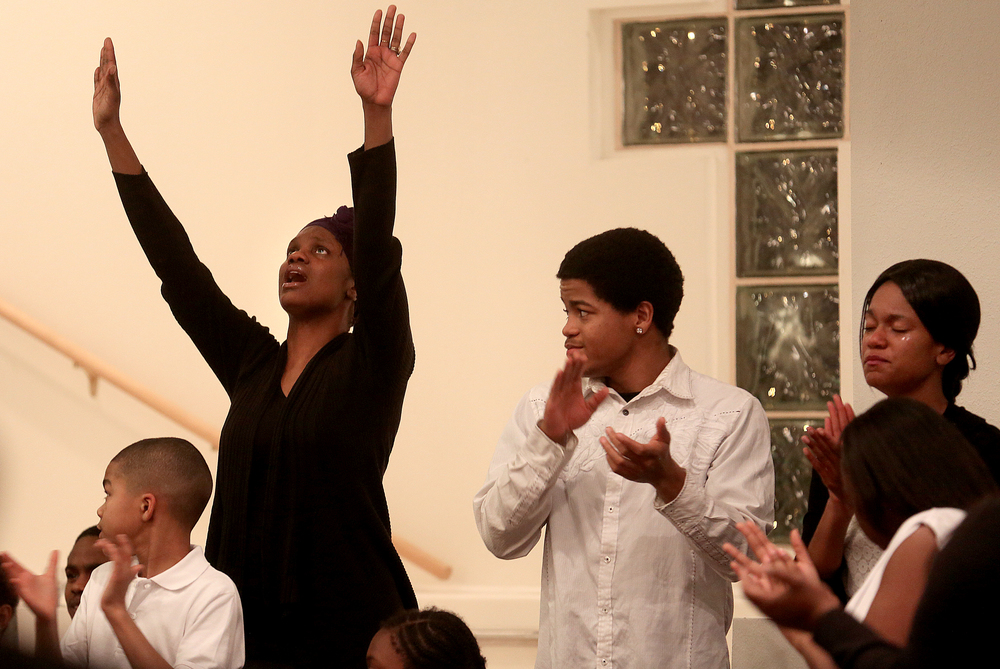 For some members of the Region II youth choir there were tears while others lifted up their arms while singing during the service Wednesday night.  David Spencer/The State Journal-Register