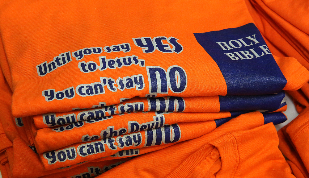 "Tee-shirts with the theme of this year's Wood River Youth Revival: ""Until you say Yes to Jesus, You can't say No to the Devil"" were for sale at a table inside Pilgrim Rest Missionary Baptist Church. David Spencer/The State Journal-Register"