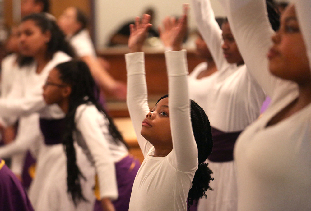 The Praise Dance Ministry, made up of Wood River youth under the direction of Yolanda Jones and Marelda Baidy, perform Wednesday night. David Spencer/The State Journal-Register
