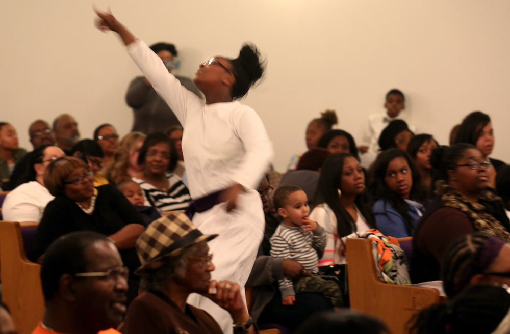Praise Dancer Mehkii Jones, a member of New Hope Missionary Baptist Church in Springfield, performs in the middle aisle of the church sanctuary Wednesday night. David Spencer/The State Journal-Register