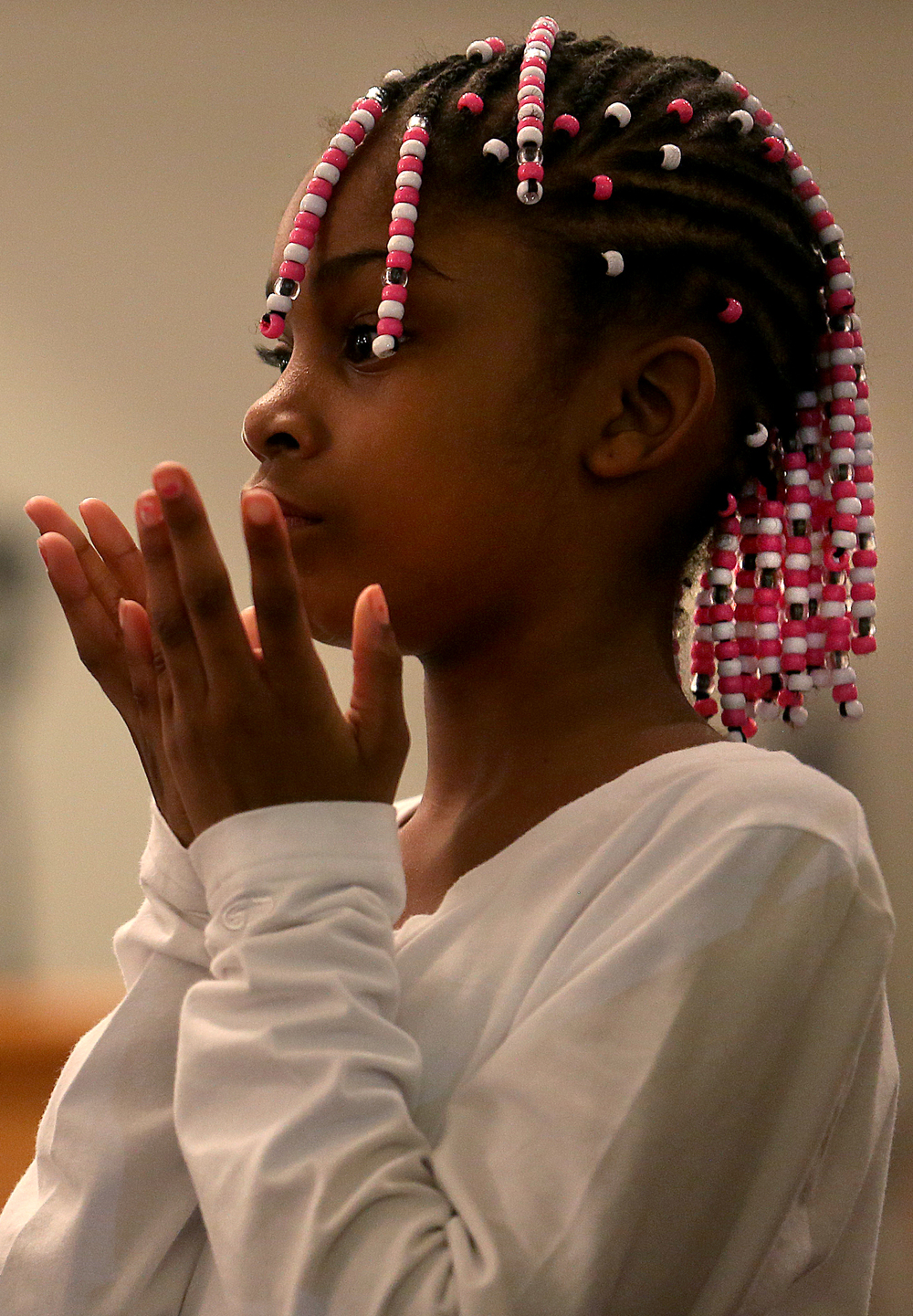 With the palms of her hands facing up towards Heaven, a young member of the Praise Dancers performs Wednesday. The group is made up of approximately 25 young people. David Spencer/The State Journal-Register