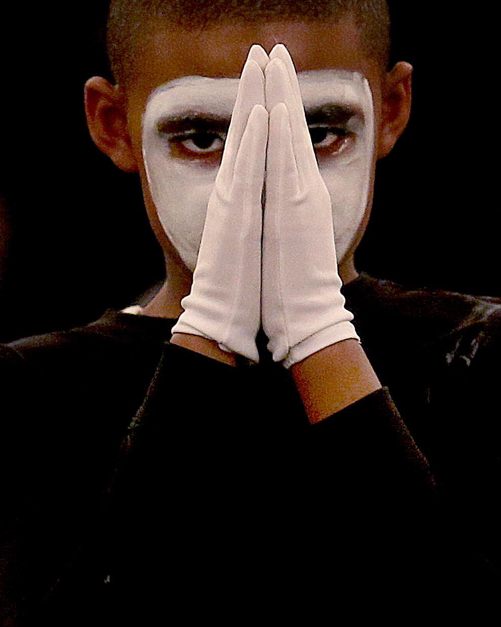 A young Mime Ministry member clasps his hands in prayer while performing. David Spencer/The State Journal-Register