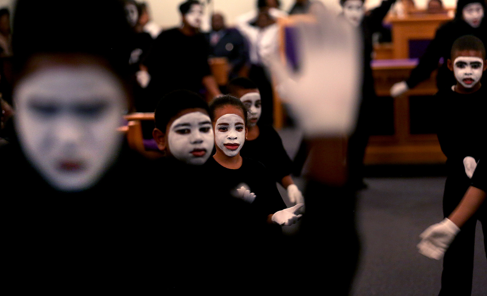 The Mime Ministry, made up of Wood River youth under the direction of Cecilia Ursin and Santina Nunn, perform Wednesday night.  David Spencer/The State Journal-Register