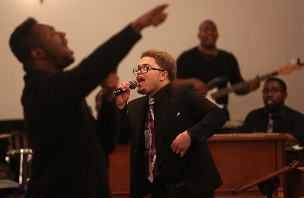 "Soloist Paul Bill Jr. , a member of Calvary Baptist Church in Springfield, performs ""Yes I Can"" late in the worship service. David Spencer/The State Journal-Register"