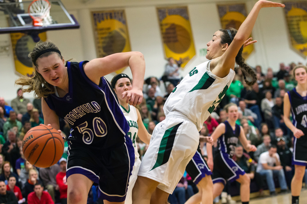Athens' JJ Penrod (22) is called for the foul as she collides with Litchfield's Abby Brockmeyer (43) in the second half during the Class 2A Williamsville sectional title game, Thursday, Feb. 19, 2015, in Williamsville, Ill. Justin L. Fowler/The State Journal-Register