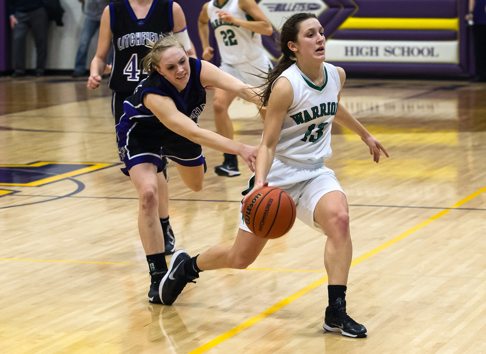 Athens' Madi Epperson (13) draws the intentional foul against Litchfield's Tessa Steffens (34) after a steal to seal the the win for Athens in the Class 2A Williamsville sectional title game, Thursday, Feb. 19, 2015, in Williamsville, Ill. Justin L. Fowler/The State Journal-Register
