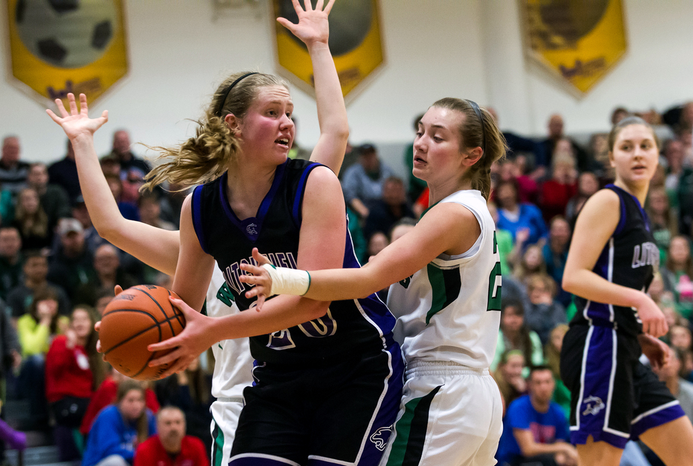 Litchfield's Anna Thomack (20) is swarmed by Athens' Lauren Ogden (20) as she tries to find an outlet to pass in the second half during the Class 2A Williamsville sectional title game, Thursday, Feb. 19, 2015, in Williamsville, Ill. Justin L. Fowler/The State Journal-Register