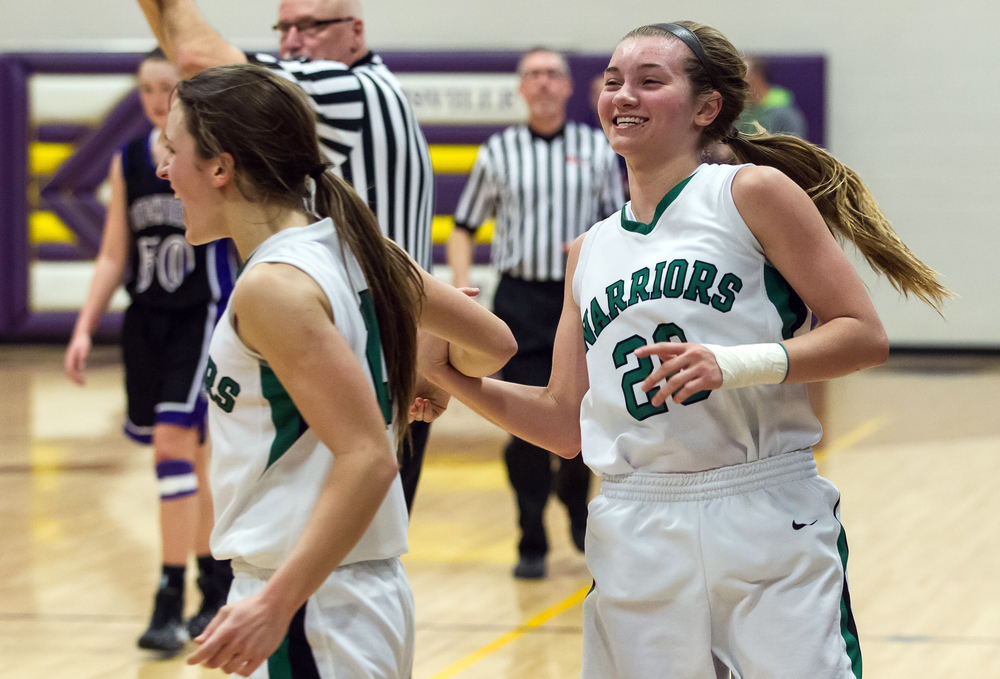 Athens' Lauren Ogden (20) reacts after Madi Epperson (13) made a steal against Litchfield to seal the win in the second half during the Class 2A Williamsville sectional title game, Thursday, Feb. 19, 2015, in Williamsville, Ill. Justin L. Fowler/The State Journal-Register