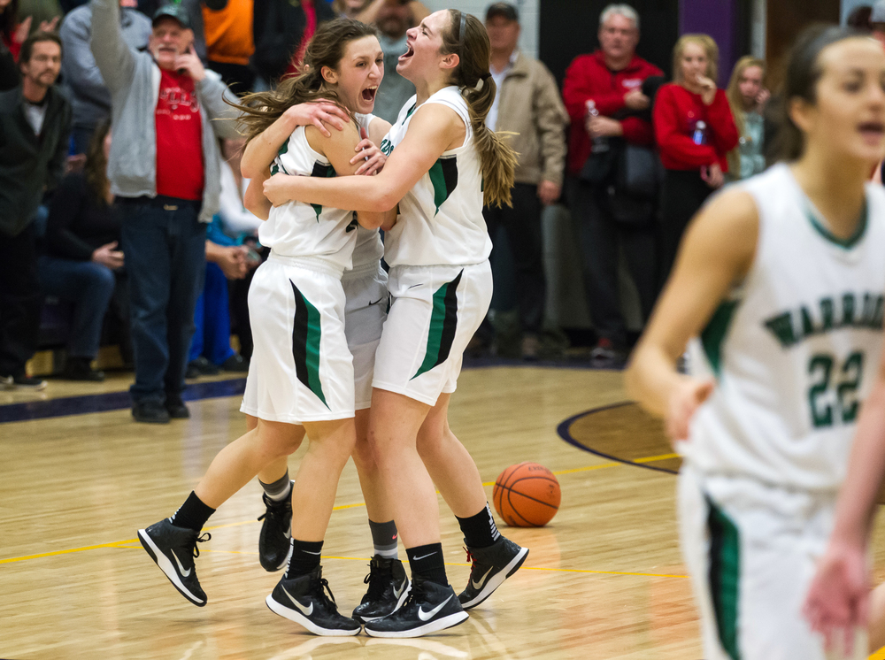 Athens' Madi Epperson (13) celebrates with Jaiden Jarrard (31) after Athens defeated Litchfield 42-38 in the Class 2A Williamsville sectional title game, Thursday, Feb. 19, 2015, in Williamsville, Ill. Justin L. Fowler/The State Journal-Register