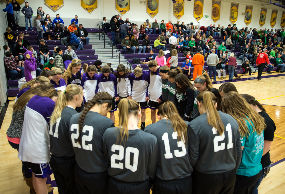The Athens and Litchfield girls basketball teams gather for a prayer prior to tip off for the Class 2A Williamsville sectional title game, Thursday, Feb. 19, 2015, in Williamsville, Ill. Justin L. Fowler/The State Journal-Register