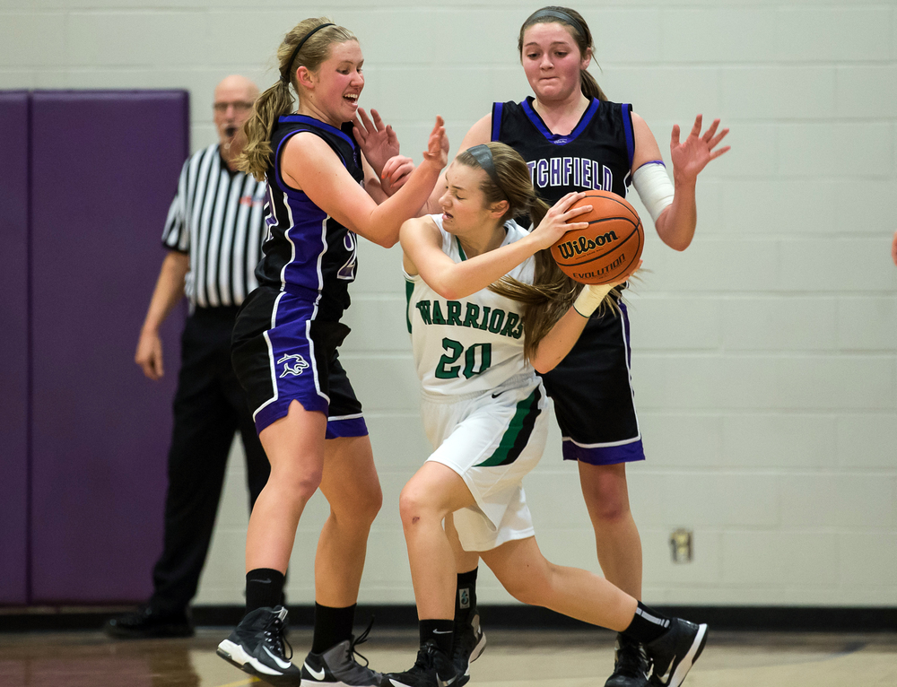 Athens' Lauren Ogden (20) is swarmed by Litchfield's Anna Thomack (20) and Litchfield's Abby Frerichs (44) in the first half during the Class 2A Williamsville sectional title game, Thursday, Feb. 19, 2015, in Williamsville, Ill. Justin L. Fowler/The State Journal-Register