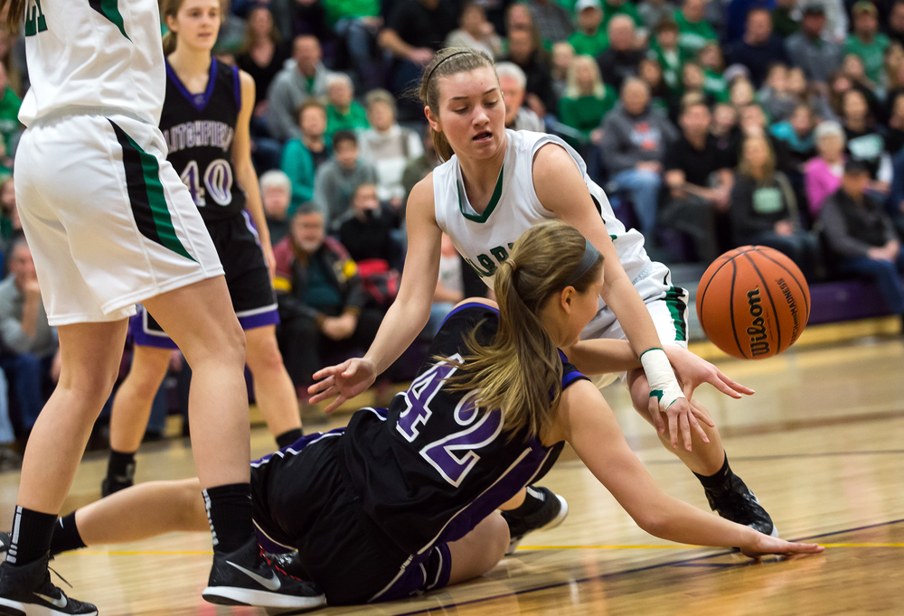 Athens' Lauren Ogden (20) fights for a loose ball against Litchfield's Ally Smith (42) in the first half during the Class 2A Williamsville sectional title game, Thursday, Feb. 19, 2015, in Williamsville, Ill. Justin L. Fowler/The State Journal-Register