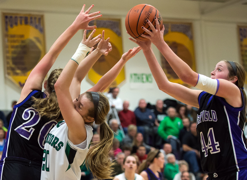 Litchfield's Abby Frerichs (44) grabs a rebound against Athens' Lauren Ogden (20) in the first half during the Class 2A Williamsville sectional title game, Thursday, Feb. 19, 2015, in Williamsville, Ill. Justin L. Fowler/The State Journal-Register