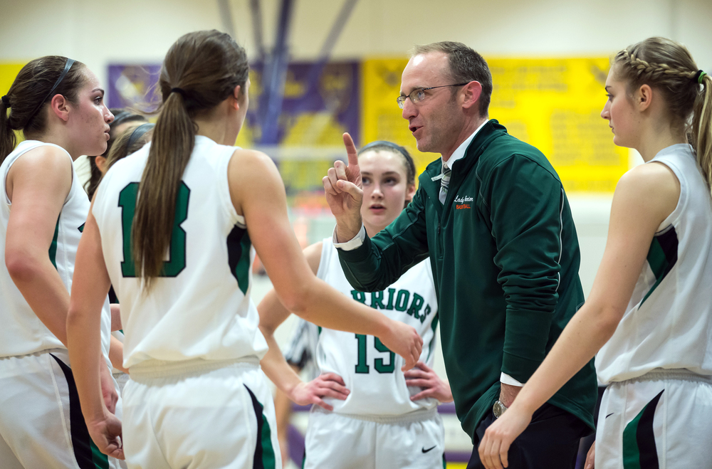 Athens girls basketball coach Jay Heriford talks to his team in a timeout as the Warriors take on Litchfield in the second half during the Class 2A Williamsville sectional title game, Thursday, Feb. 19, 2015, in Williamsville, Ill. Justin L. Fowler/The State Journal-Register
