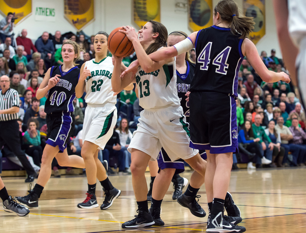 Athens' Madi Epperson (13) puts up a basket against the arm of Litchfield's Abby Frerichs (44) in the second half during the Class 2A Williamsville sectional title game, Thursday, Feb. 19, 2015, in Williamsville, Ill. Justin L. Fowler/The State Journal-Register