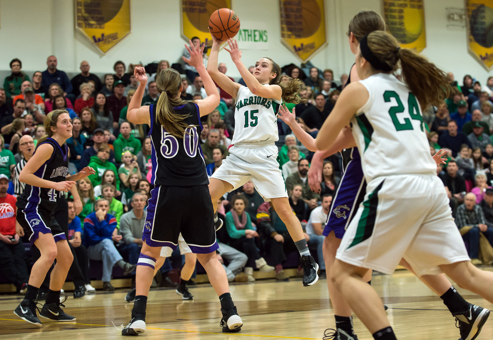 Athens' Emily Nordsiek (15) puts up a shot against Litchfield's Abby Brockmeyer (50) in the second half during the Class 2A Williamsville sectional title game, Thursday, Feb. 19, 2015, in Williamsville, Ill. Justin L. Fowler/The State Journal-Register