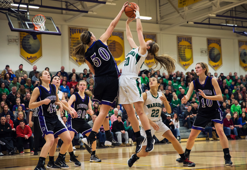 Athens' Lauren Ogden (20) has her shot blocked by Litchfield's Abby Brockmeyer (50) in the second half during the Class 2A Williamsville sectional title game, Thursday, Feb. 19, 2015, in Williamsville, Ill. Justin L. Fowler/The State Journal-Register