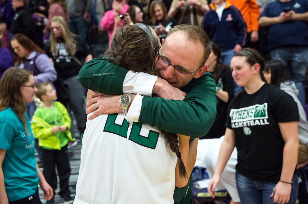 Athens girls basketball coach Jay Heriford hugs Athens' JJ Penrod (22) after the Warriors defeated Litchfield 42-38 in the Class 2A Williamsville sectional title game, Thursday, Feb. 19, 2015, in Williamsville, Ill. Justin L. Fowler/The State Journal-Register