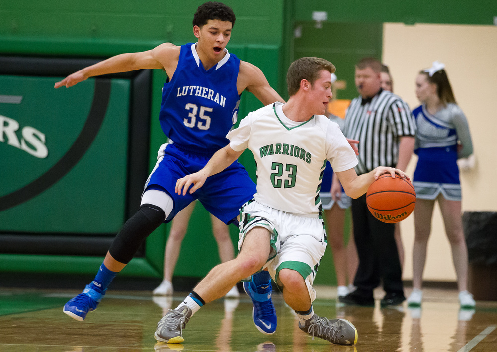 Athens' Ryan Freer (23) tries to dribble around the pressure from Lutheran's Pierson Wofford (35) in the first half at Athens High School, Friday, Feb. 20, 2015, in Athens, Ill. Justin L. Fowler/The State Journal-Register